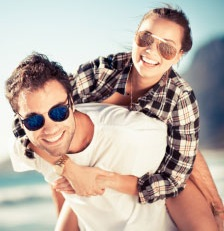 image of man and womand wearing sunglasses.